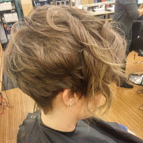 pixie cut with a curly strand