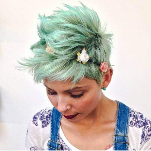 woman with a green long pixie cut
