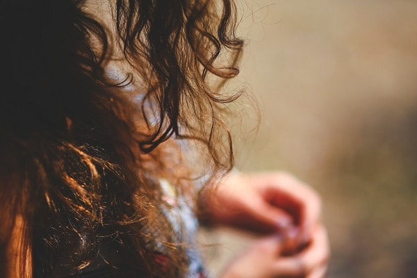 close up on a woman's frizzy curly hair