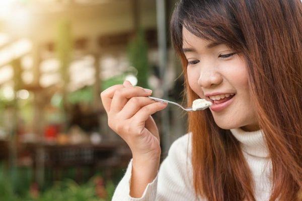 Woman eating with a spoon