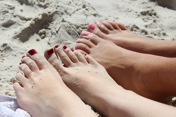 feet in the sand, at the beach