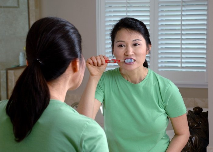 brushing teeth is a form of preventing white spots