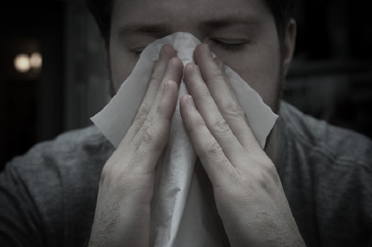 man suffering from seasonal allergies