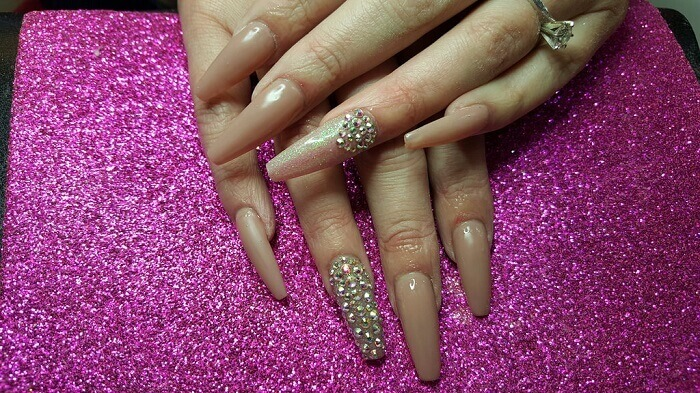 a woman's hands with coffin nails