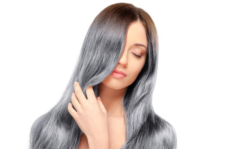 young woman wearing the gray hair trend