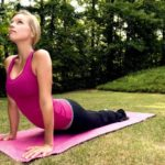 a young girl doing a yoga pose