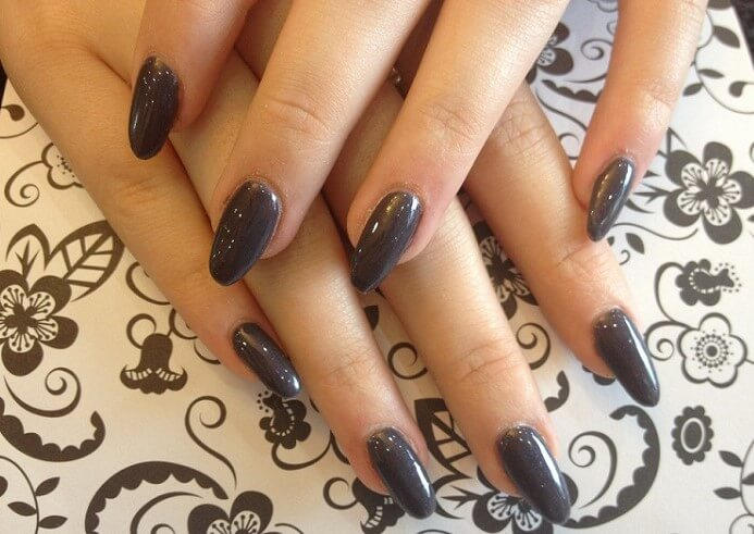 a woman's hand with acrylic manicure