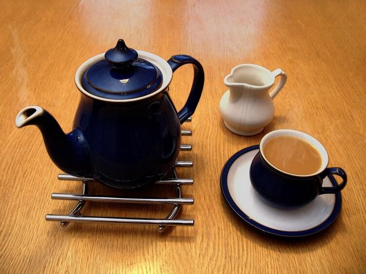 a tea kettle and a tea cup