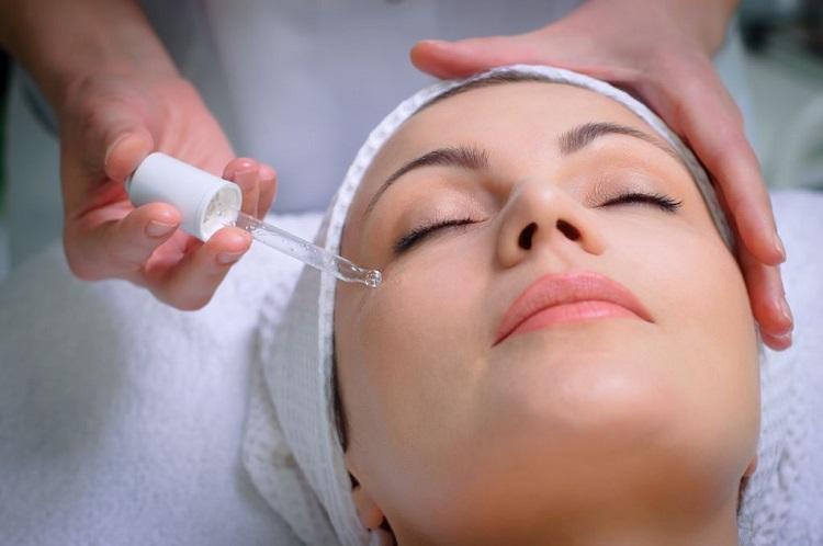 a young woman having a facial treatment