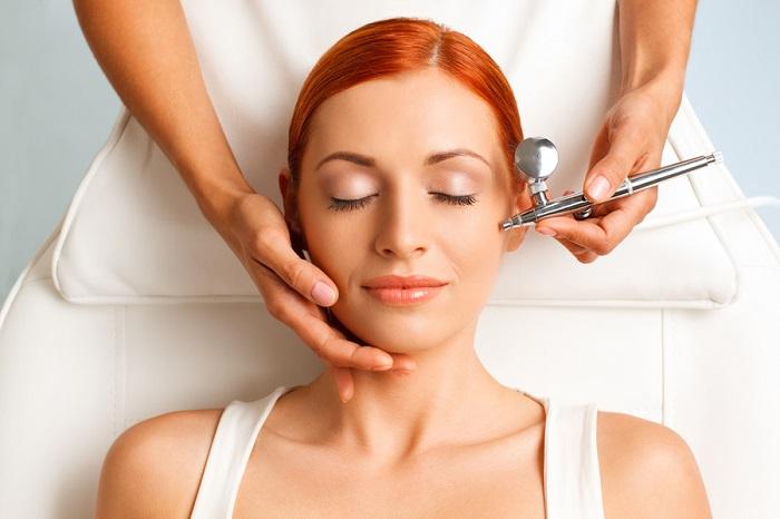 female having an oxygen facial treatment