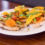 a dish with healthy food chicken and veggies