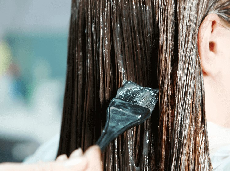 a woman's hair with treatment oil on it