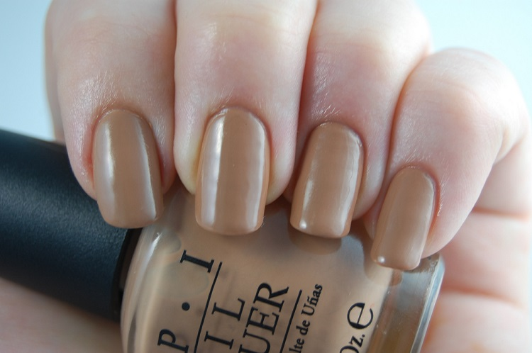 beige nail polish on a woman'd hand
