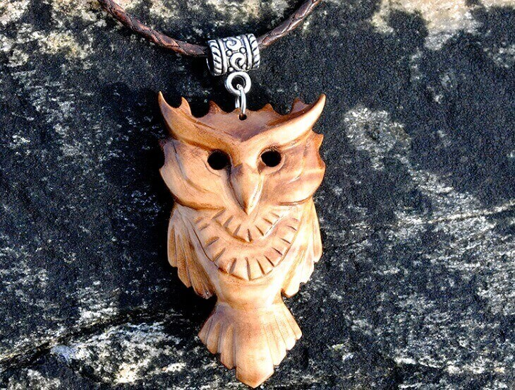 a necklace with an owl-shaped pendant
