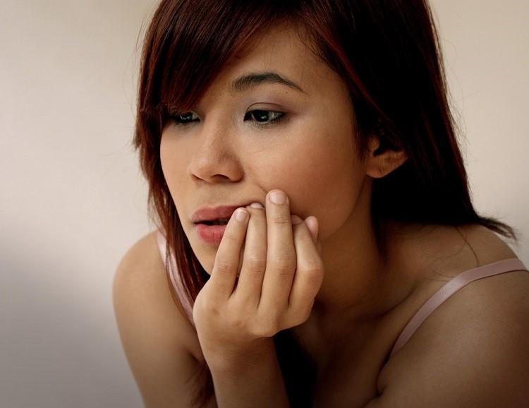 a girl having a toothache