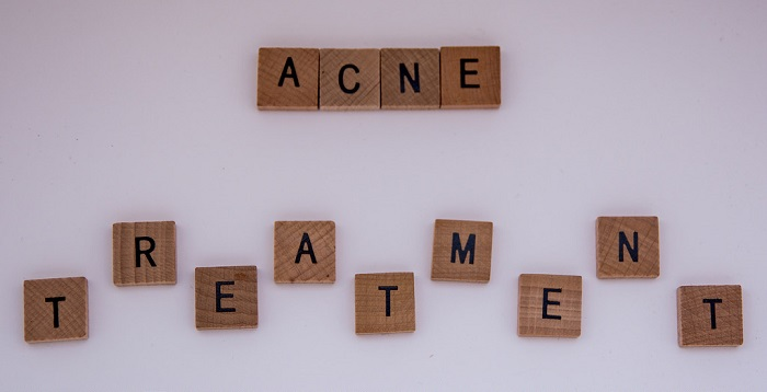 the words acne treatment made of scrabble pieces