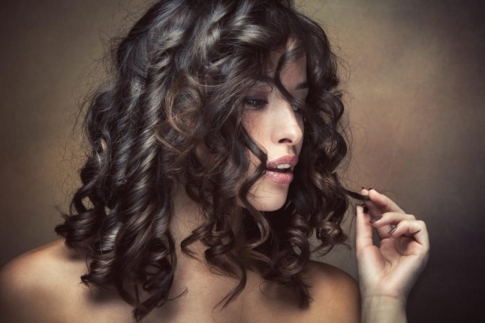 medium-sized brunette curly hair