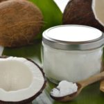 fresh coconut fruit and coconut oil in a jar