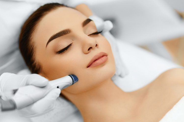 a microdermabrasion procedure done on a young woman