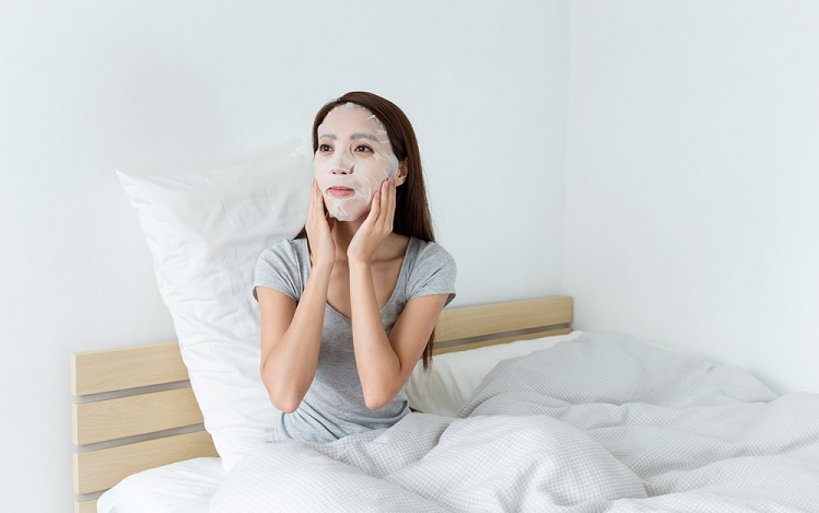 a woman with a face sheet mask on