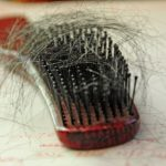 a hairbrush with hairs on it