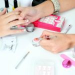 a cosmetic specialist doing a woman's manicure