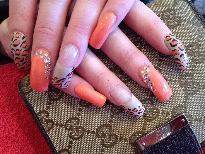 long nails colored with a peach shade of polish