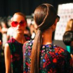 a model with her hair styled in a ponytail