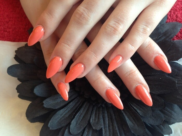Long Stiletto Nails In A Peachy Color
