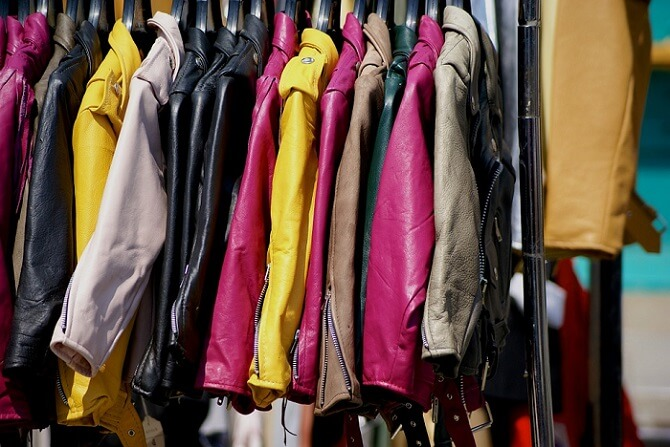a lot of jackets on a store rack