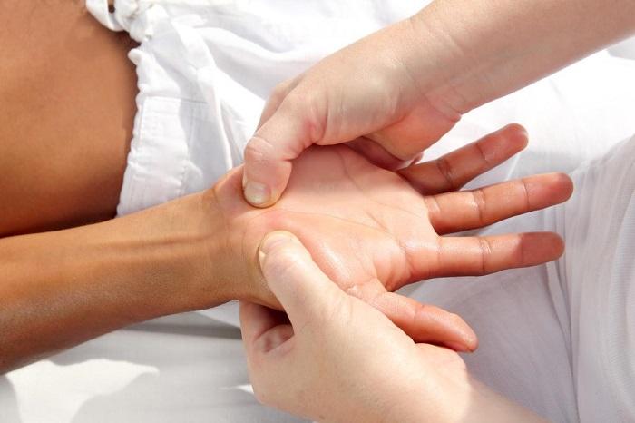 applying pressure to someone's hand