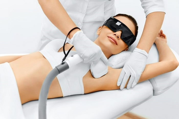 a woman doing a laser hair removal procedure