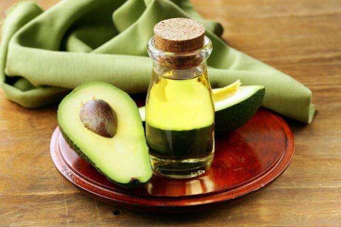 Avocado Oil for Skin on Plane Next to Avocado