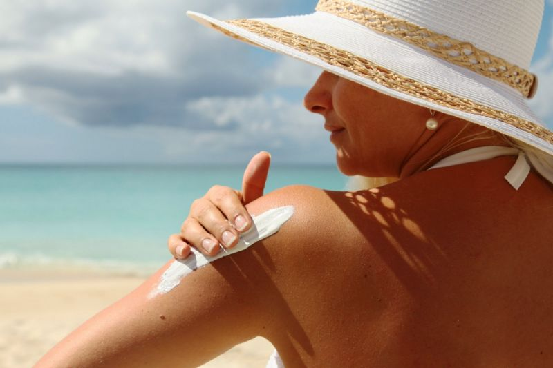 Woman Putting on Natural Sunscreen