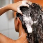 woman shampooing her hair