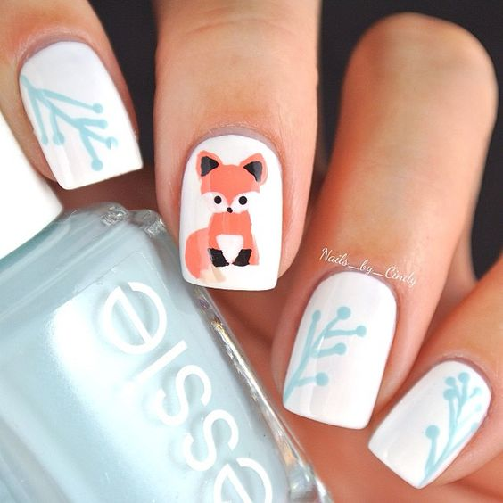 white nails with a fox on the middle nail