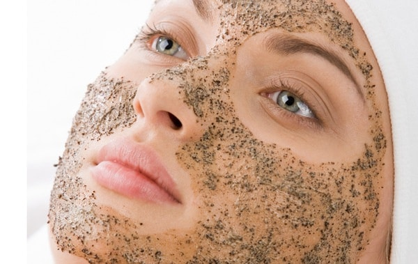 Woman using a scrub for face