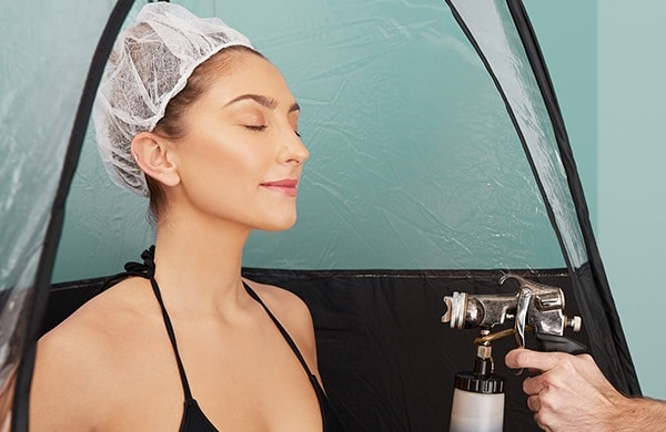 Woman getting spray tanned