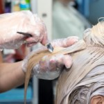 Blonde woman getting her hair dyed
