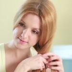 Woman braiding hair