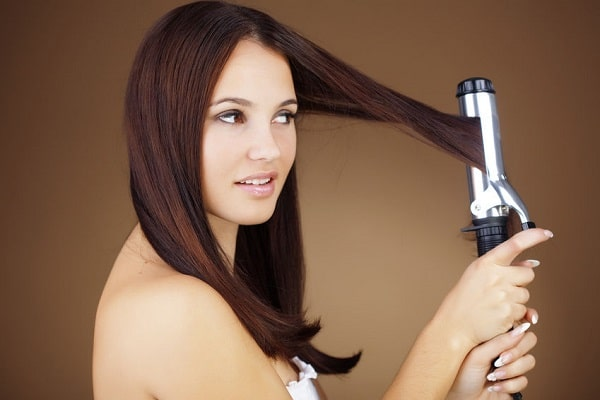 Woman using a curling wand