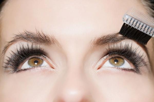 Woman brushing eyebrows