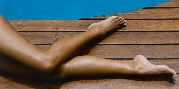Woman laying by the pool