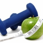 An apple and some blue weights