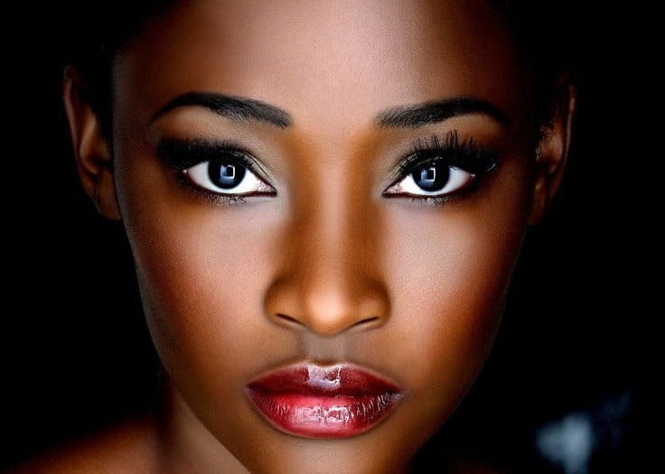 A black, brunette woman wearing natural makeup