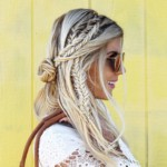 Hippie braids and fishtail braids with small buns in a blonde girl's hair