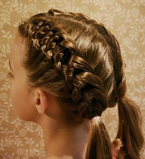 Knotted braids on blonde girl's hair