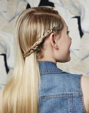 Mini Dutch side braid on a blonde girl's hair