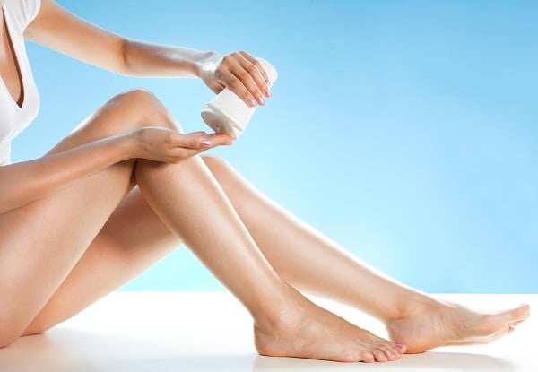 Woman putting lotion in her hand