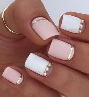 6 cute pink nail designs you definitely need to try light pink and white nail polish on nails with white pearls and golden stickers prinsesfo Gallery
